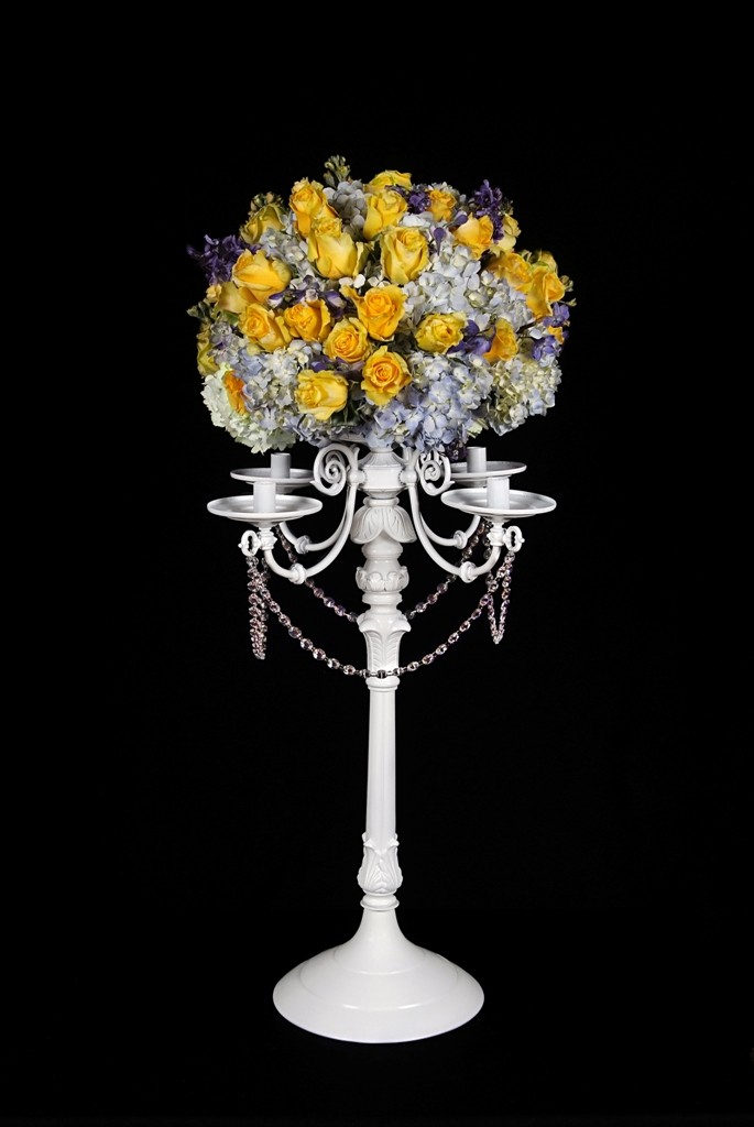 WC100 A traditional style candelabra in white. 30